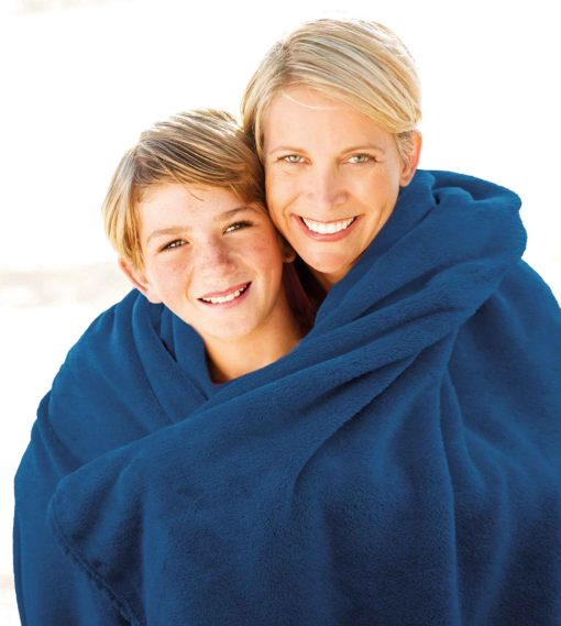 mother-with-blanket-embracing-son-at-beach